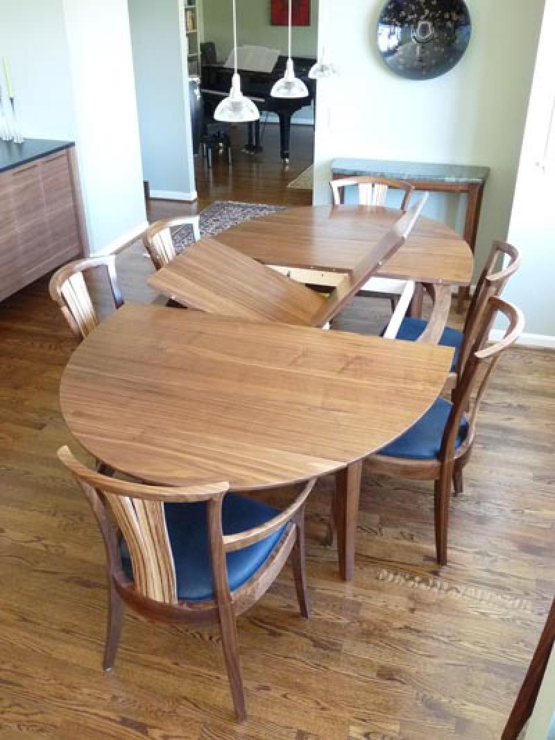 Walnut Medium Grande Laurel Dining Table shown with Neo chairs