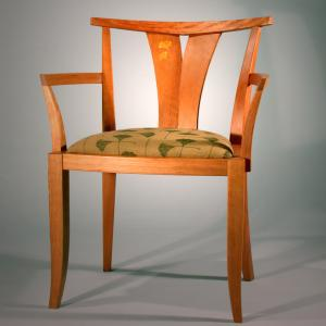 Dining chair in cherry with a cushioned seat