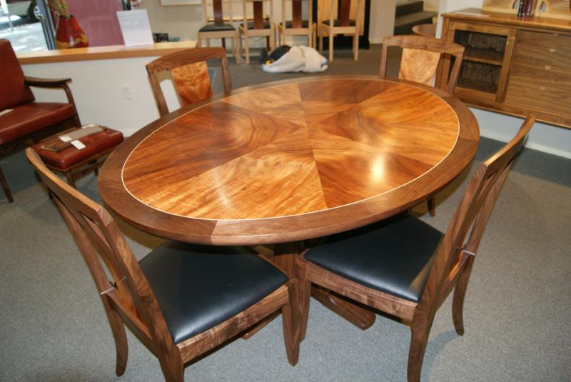 star oval dining table walnut and koa