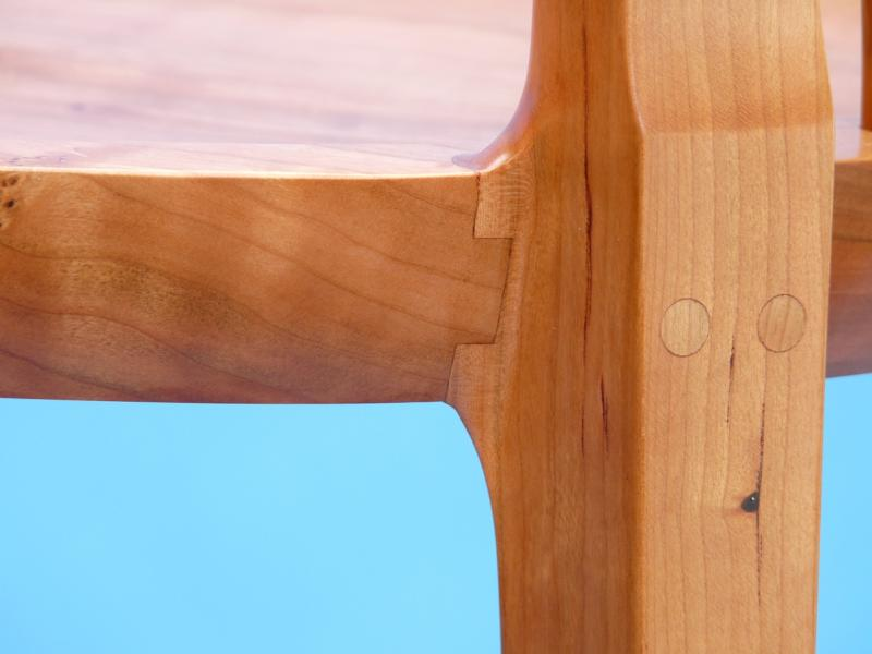 "Detail of the joint that holds these bar stools together. They are cut from 2 1/2"" thick boards"