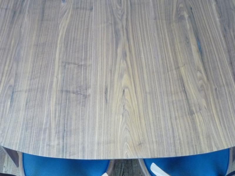 Center board is split where the table opens to recieve the leaf that's hinged and stored inside the table body.