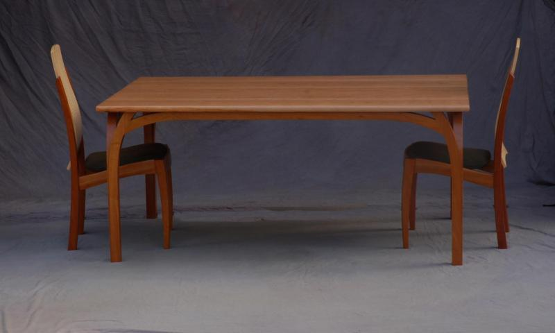 Roland Dining Table Cherry top and base, shown with Lopez Chair