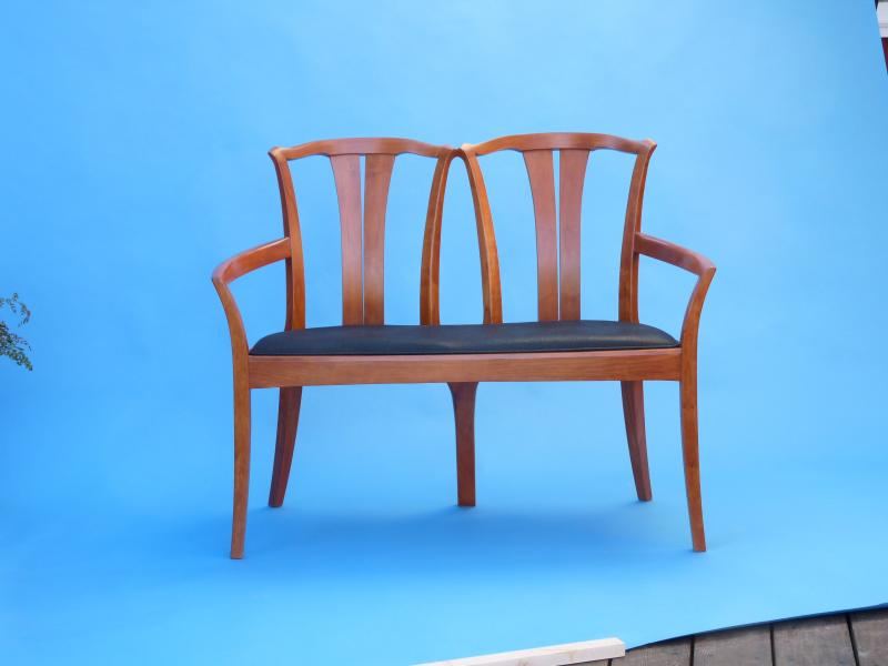 "When I designed this for a show in 2000, I realized the larger arch of the back rest allowed me to design the Grande sized chairs I make, These chairs are 1 1/2"" wider than my Original chairs"