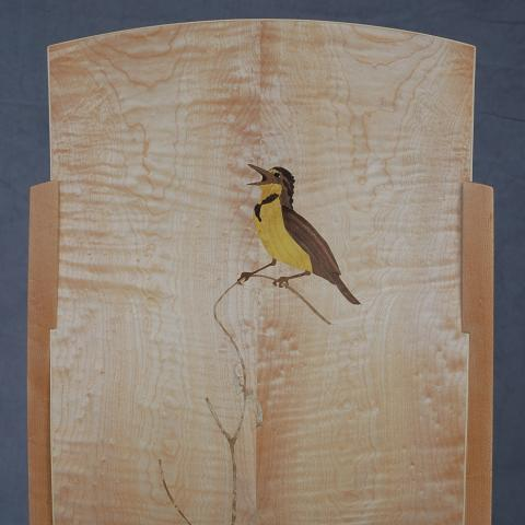 Bird composed with marquetry inlaid into curly maple chair back